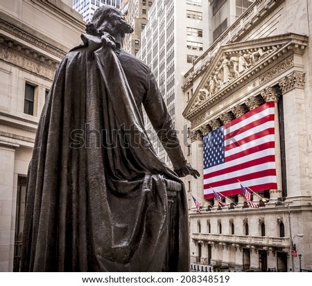 NEW YORK, USA - APRIL 21: Image of The famous Wall Street in New York city, USA showcasing the stock exchange building with a huge American Flag and the statue of George Washington on April 21, 2014. - stock photo