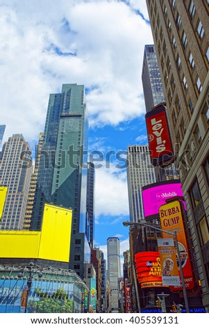 NEW YORK, USA - APRIL 24, 2015: Intersection of 7th Avenue and West 44th Street in Midtown Manhattan, New York, USA. It is Times Square. It is a commercial intersection between Broadway and 7th Avenue - stock photo