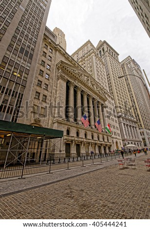 NEW YORK, USA - APRIL 24, 2015: New York Stock Exchange on Wall Street of Lower Manhattan, USA. It is called NYSE in short. Tourists nearby. - stock photo