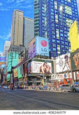 New York, USA - April 26, 2015: Pedestrians on Broadway in Times Square. Skyscrapers in Midtown Manhattan in New York, USA. - stock photo