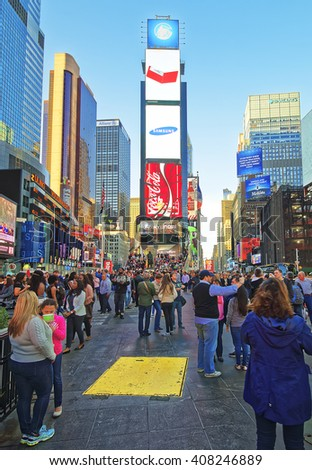 New York, USA - April 25, 2015: Pedestrians on 7th Avenue and Broadway in Times Square. Skyscrapers in Midtown Manhattan in New York, USA. It is a commercial junction of Broadway and 7th Avenue. - stock photo