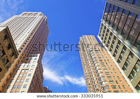 NEW YORK, USA - APRIL 25, 2015: Tall brick and glass skyscrapers at busy and crowded Manhattan in New York City, USA - stock photo