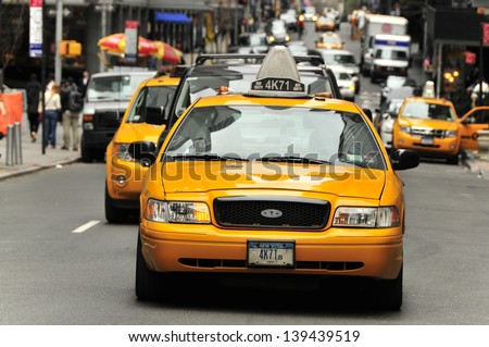 NEW YORK, USA - APRIL 11: Taxis in the traffic, Manhattan, April 11, 2012 in New York City. The city is planning to replace its fleet of various kinds of taxis with one model.  - stock photo