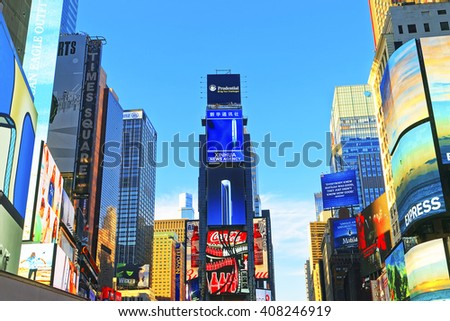 New York, USA - April 26, 2015: 7th Avenue and Broadway skyscrapers in Midtown Manhattan in New York, USA. It is called Times Square. It is a commercial junction of Broadway and 7th Avenue. - stock photo