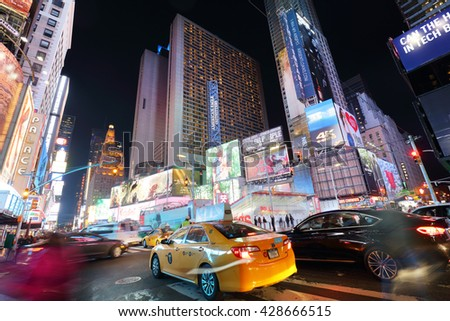NEW YORK, USA - APRIL 12: The architecture of the Times Square in New York city, USA with its neon lights and panels at night and a lot of tourists passing by on April 12, 2016. - stock photo