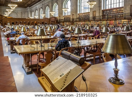 NEW YORK, USA - APRIL 26, 2009: View of the New York Public Library showcasing its historic architecture with locals and students reading books and surfing on the Internet on April 26, 2009. - stock photo