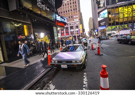 NEW YORK, USA - AUG 21, 2015:  people admire the famous original amc chrome car from the film back to the future presented at time square due to 25th anniversary of the Hollywood film.