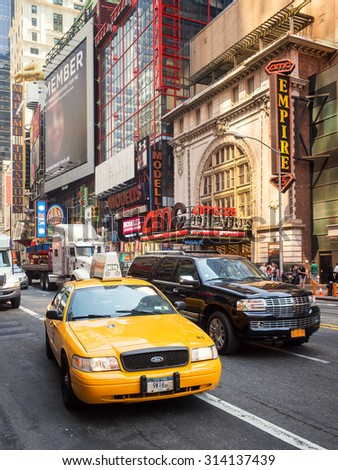 NEW YORK,USA- AUGUST 14,2015 : An iconic New York Yellow cab in the traffic of 42nd street in downtown Manhattan - stock photo