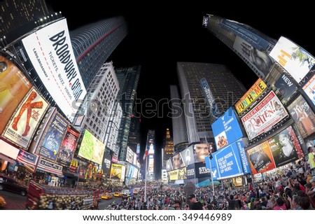 NEW YORK, USA - AUGUST 18, 2015: Fisheye lens photo of Times Square crowded with tourists at night with Broadway Theaters and animated LED signs.