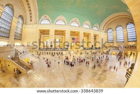 NEW YORK, USA - AUGUST 15, 2015: Fisheye lens picture of commuters in motion in the Grand Central Terminal main hall during busy day. - stock photo