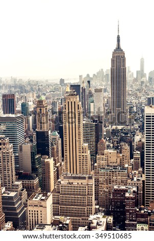 NEW YORK, USA - AUGUST 12, 2013: Manhattan aerial view with Empire State building in New York City. Empire State is a 102-story landmark and was world's tallest building for more than 40 years. - stock photo