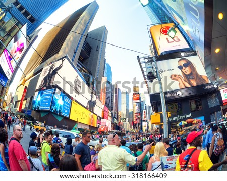 NEW YORK,USA - AUGUST 14,2015 : Tourists and locals crowd at famous Times Square in New York City - stock photo