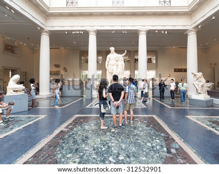 NEW YORK,USA - AUGUST 14,2015 : Visitors admiring ancient greek and roman art at the Metropolitan Museum of Art in Manhattan - stock photo