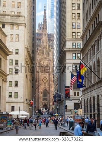 NEW YORK,USA - AUGUST 13,2015 :  Wall Street on Manhattan Financial District with Trinity Church on the background