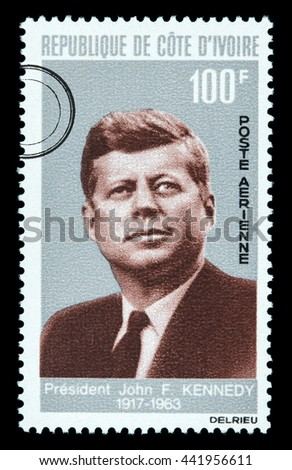 NEW YORK, USA - CIRCA 2016: A postage stamp printed in Cote D'ivoire (Ivory Coast) showing John F. Kennedy, circa 1964 - stock photo