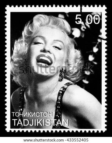 NEW YORK, USA - CIRCA 2010: A postage stamp printed in Tadjikistan showing Marilyn Monroe, circa 2000 - stock photo