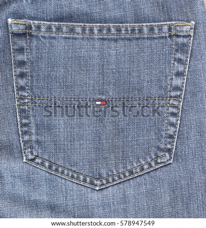 NEW YORK, USA - CIRCA JANUARY 2017: Tommy Hilfiger blue jeans detail of a back pocket with logo