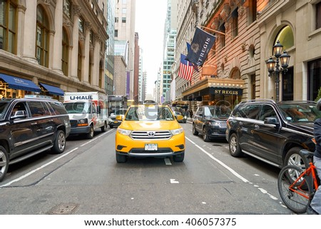 NEW YORK, USA - CIRCA MARCH, 2016: yellow taxi in New York City at daytime. New York is the most populous city in the United States.