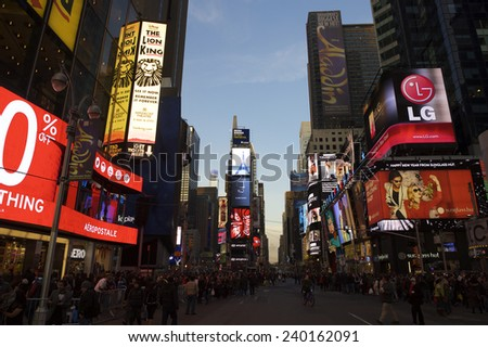 NEW YORK, USA - DECEMBER 27, 2014: Crowds gather under the bright lights of Times Square in the build-up to New Year's Eve. - stock photo