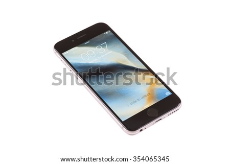 New York, USA - December 14, 2015: Front view of a space grey color iPhone 6S showing the home screen with iOS9. Isolated on white.