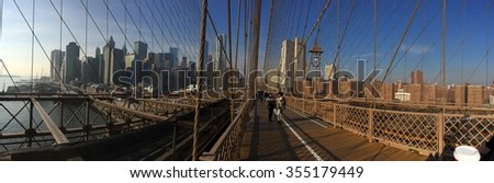 New York, USA - December 10, 2015: Sunny day on famous Brooklyn bridge in New York City. Mobile photo.
