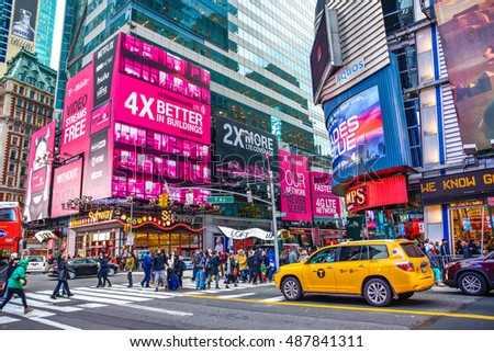 NEW YORK, USA - DECEMBER 28: Times Square crowds and traffic in the evening near Subway Station, located on 42nd Street and Eighth Avenue in Midtown Manhattan.  December 28, 2015 in New York, USA.