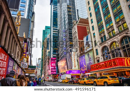 NEW YORK, USA - DECEMBER 28: Times Square crowds and traffic in the evening  with Broadway Theaters and animated LED signs in Midtown Manhattan. December 28, 2015 in New York, USA.
