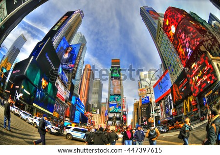 NEW YORK, USA, FEB 6: Colorful high dynamic range (HDR) image of the Times Square on a cloudy blue sky through fisheye lens, NYC, USA, Feb 6, 2016  - stock photo