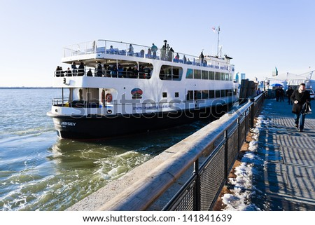 NEW YORK, USA - FEBRUARY 5: Cruise Ship in New York on February 5, 2010. 75-minute cruise sails from Midtown out to Liberty Island for a close-up look at Statue of Liberty and Ellis Island - stock photo