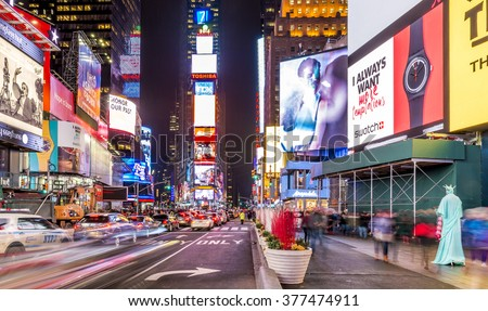 NEW YORK, USA - FEBRUARY 12: The architecture of the famous Times Square in New York city, USA with its neon lights and panels at night and a lot of tourists passing by on February 12, 2016. - stock photo