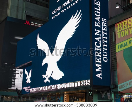 NEW YORK,USA-JULY 5,2015:American Eagle ad in Times Square in New York City night scenes.The tourist landmark is visited by about 50 million tourists every year  - stock photo