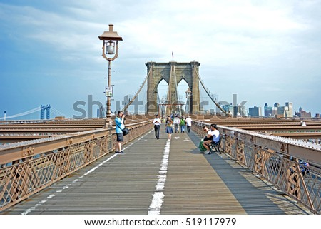 NEW YORK-USA-JULY 10 : brooklyn bridge close up with manhattan skyline in the background shot early morning before the tourists arrived, July 10, 2014  New york USA