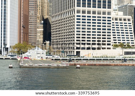 NEW YORK,USA-JULY 3,2015:Downtown Manhattan Heliport on the East river in New York city.Also called Wall Street Heliport is owned by the Port Authority of New York and New Jersey. - stock photo