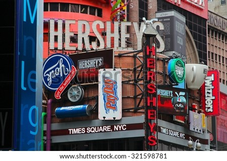 NEW YORK, USA - JULY 3, 2013: Famous Hershey's ad at Times Square in New York. Hershey Company is a chocolate manufacturer founded in 1894. It employs 13,700 people (2010). - stock photo