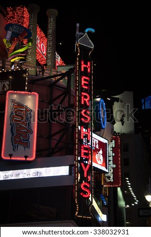 NEW YORK,USA-JULY 5,2015:Hershey's ad in Times Square in New York City night scenes. The tourist landmark is visited by about 50 million tourists every year  - stock photo