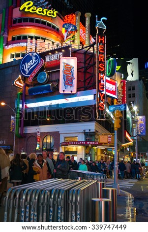 NEW YORK,USA-JULY 3,2015:New York Times Square night scenes featuring the crowd and neon ads. The tourist landmark is visited by about 50 million tourists every year a - stock photo