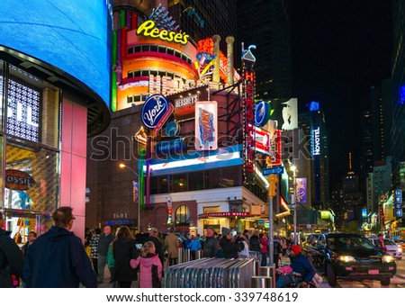 NEW YORK,USA-JULY 3,2015:New York Times Square night scenes featuring the crowd and neon ads. The tourist landmark is visited by about 50 million tourists every year  - stock photo