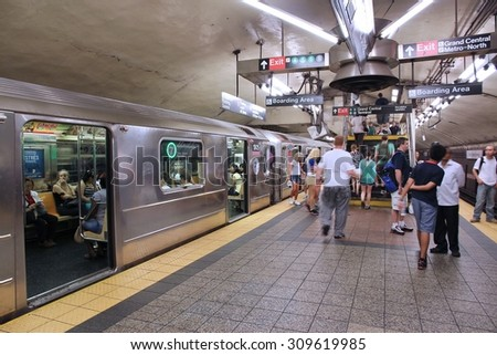 NEW YORK, USA - JULY 3, 2013: People exit the Grand Central Terminal subway station in New York. With 1.67 billion annual rides, New York City Subway is the 7th busiest metro system in the world. - stock photo