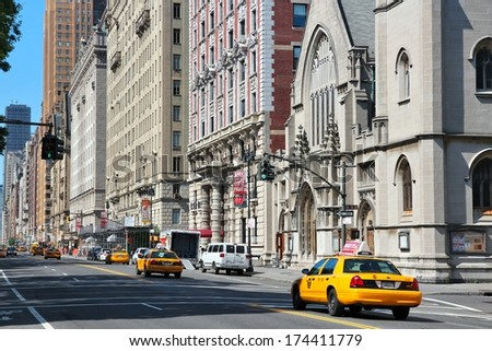 NEW YORK, USA - JULY 6, 2013: People ride yellow taxi at Central Park West in New York. As of 2012 there were 13,237 yellow taxi cabs registered in New York City. - stock photo