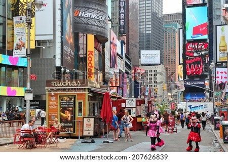NEW YORK, USA - JULY 3, 2013: People visit Times Square in New York. Times Square is one of most recognized landmarks in the world. More than 300,000 people pass through Times Square daily. - stock photo