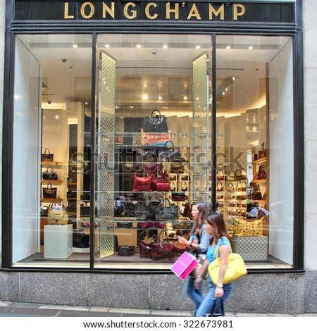 NEW YORK, USA - JULY 1, 2013: People walk past Longchamp store in New York City. The famous leather goods company has some 2,000 stores in some 100 countries worldwide. - stock photo