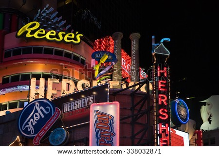 NEW YORK,USA-JULY 5,2015:Reese and other ads in Times Square in New York City night scenes.The tourist landmark is visited by about 50 million tourists every year  - stock photo