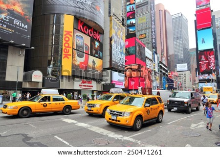 NEW YORK, USA - JULY 3, 2013: Taxis drive along Times Square in New York. Times Square is one of most recognized landmarks in the USA. More than 300,000 people visit Times Square every day. - stock photo