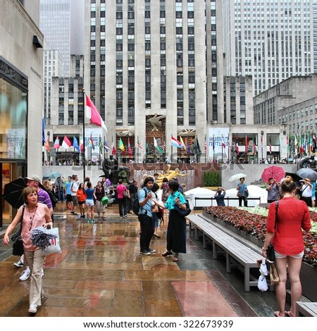 NEW YORK, USA - JULY 1, 2013: Tourists visit Rockefeller Center in New York. Rockefeller Center is one of most recognized landmarks in the United States and is a National Historic Landmark.