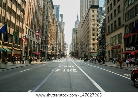 NEW YORK, USA - JULY 13, 2008: Unidentified people on the street of New York at July 13, 2008. At 2010 population of New York City was more than 19 million. - stock photo
