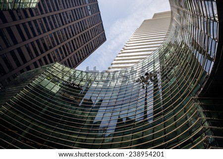 NEW YORK, USA - Jun 01, 2014: Manhattan modern architecture. Manhattan is the most densely populated of the five boroughs of New York City - stock photo