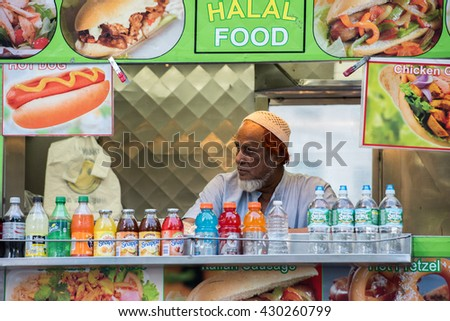 NEW YORK - USA - 13 JUNE 2015 - Arabic man while selling halal food on street