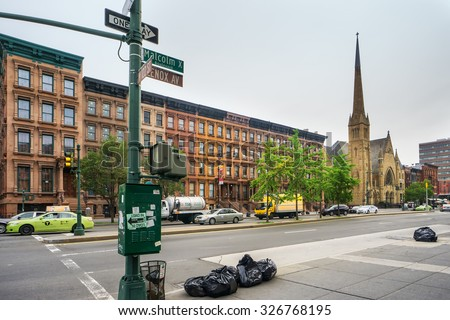 NEW YORK, USA - JUNE 16, 2015: Malcolm X Boulevard in Harlem district. Harlem is a large neighborhood of the New York City, known as a major African American residential center. - stock photo