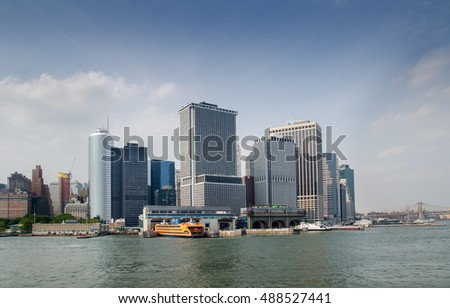 NEW YORK, USA - JUNE 10, 2015: Manhattan Skyline view with Staten Island Ferry Whitehall Terminal over Hudson River