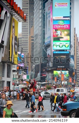 NEW YORK, USA - JUNE 10, 2013: People visit Times Square in New York. Times Square is one of most recognized landmarks in the world. More than 300,000 people pass through Times Square daily. - stock photo